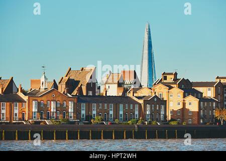 View on the riverside in old part of London with skyscraper The Shard at background. - Stock Photo