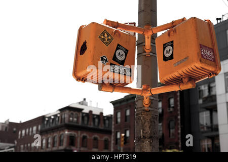 Pedestrian crossing lights,covered with stickers and graffiti in Lower East Side, New York - Stock Photo