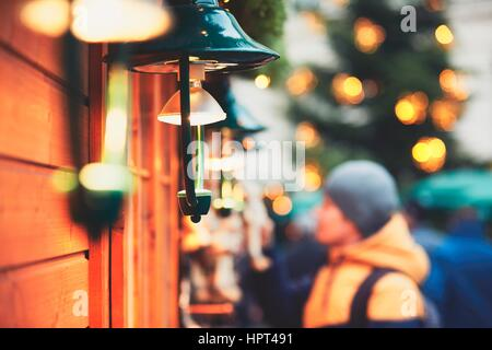 Young man in christmas market, Vienna, Austria - Stock Photo