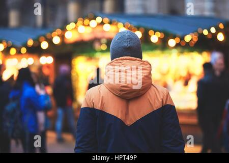 Young man in christmas market, Vienna, Austria - Stock Photo