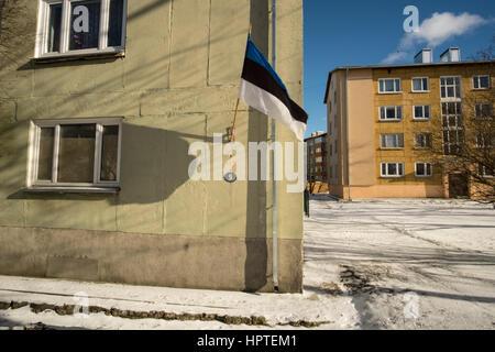 Tallinn, Estonia, 24th Febrary 2017. The Estonian national flag is seen on a Majaka street building. Estonia celebrates - Stock Photo