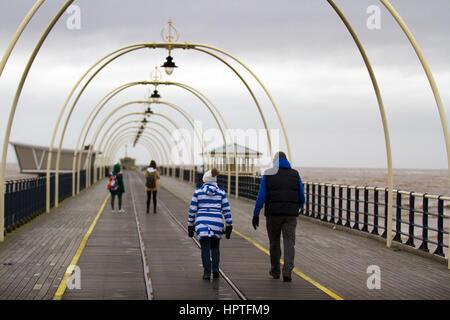 Southport, Merseyside, UK.  Weather.  25th February, 2017. Cold, Wet and Windy for foreign tourist's walking on - Stock Photo