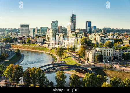 Lithuania, Vilnius, view to the modern city of Vilnius with Europa Tower and Neris River in the foreground - Stock Photo