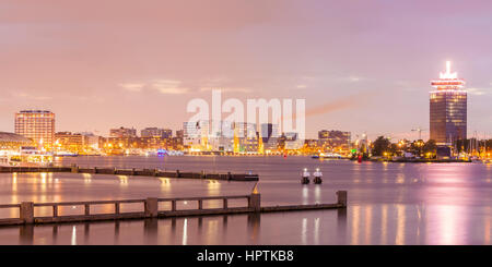 Netherlands, Amsterdam, view to Westerdok, IJDock and A'Dam Lookout at twilight - Stock Photo