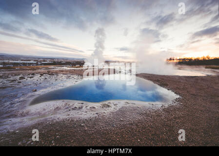 Iceand, Haukadalur valley, Geothermal site with hot spring - Stock Photo