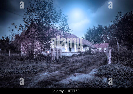 Old spooky abandoned ghost house - Stock Photo