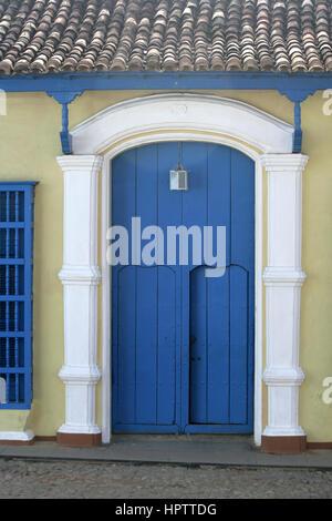 Cuban street scene. Blue Door- Old Blue Wooden Door in Trinidad , Cuba. - Stock Photo