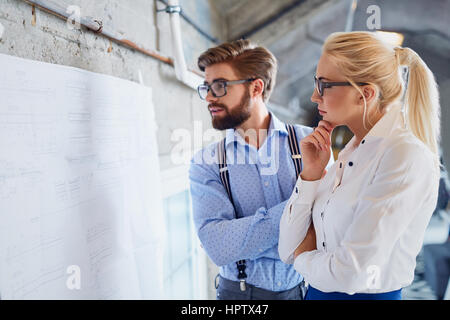 Two designers thinking brainstorming new project at modern office - Stock Photo
