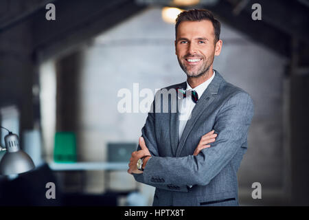 Successful manager, businessman standing in office - Stock Photo