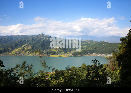 Aerial  view of Pokhara with the lake & mountains in the background, Nepal - Stock Photo