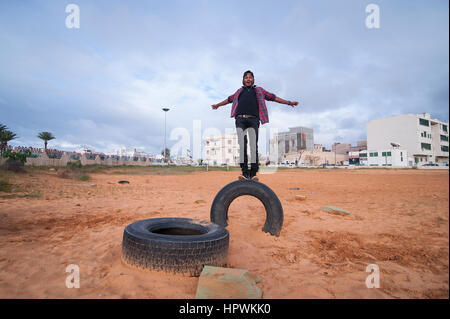Libya, Tripli: Young guys practising parkour moves. - Stock Photo