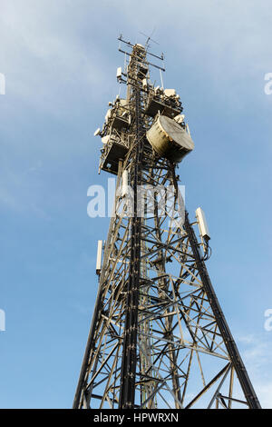 Looking up at a telecommunications mast or microwave tower in Highgate Village, London, UK - Stock Photo