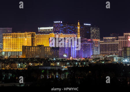 Editorial night view of Cosmopolitan, Ballys, Paris and other casino resorts on the Las Vegas strip. - Stock Photo