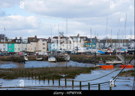 Shoreham harbour and village with Sussex Yacht club and mud flats with boats and yachts on a sunny day with puffy - Stock Photo