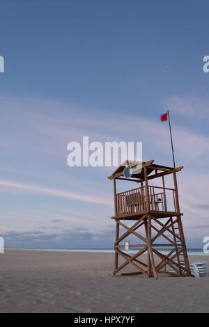 A Lifeguard Tower on a Sandy Beach - Stock Photo