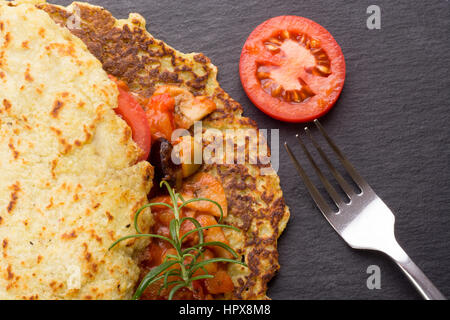 Homemade potato pancake with stew. Hungarian or Slovak cuisine. Top view - Stock Photo