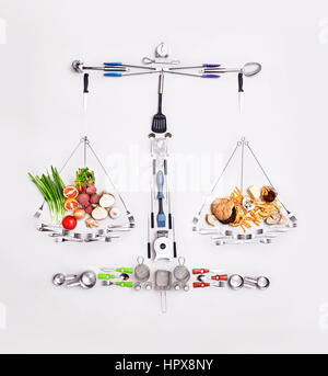 Still life concept healthy and unhealthy foods forming scale - Stock Photo