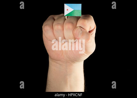 Man hand fist with Djibouti flag isolated on black background - Stock Photo