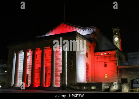 Southampton Guildhall, Hampshire, UK, lit up in the colours of Southampton Football club at night - Stock Photo