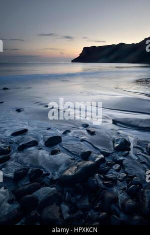 Stones in the sand on the beach of Talisker Bay, Isle of Skye, Scotland, United Kingdom