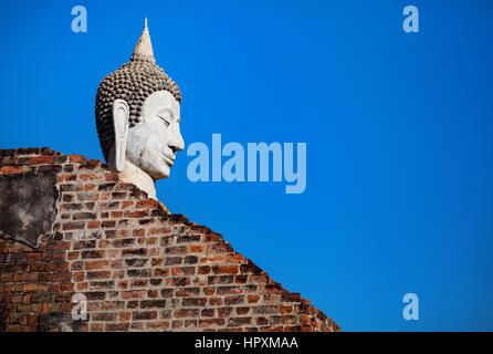 Big Buddha statue in Wat Yai Chai Mongkol monastery at blue sky in Ayuttaya, Thailand - Stock Photo