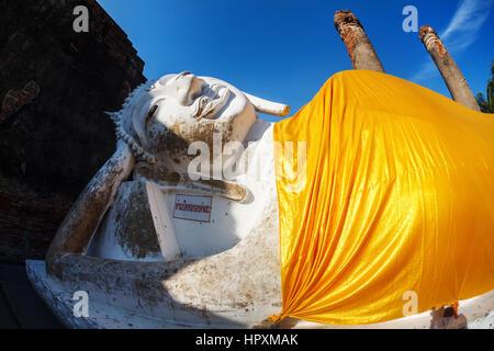 Big Lying Buddha statue with yellow robe in Wat Yai Chai Mongkol monastery in Ayuttaya, Thailand - Stock Photo
