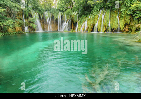 Beautiful Turquoise Lake and Waterfalls at Plitvice Lakes National Park in Croatia. - Stock Photo