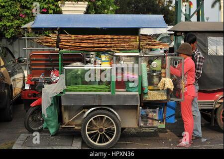 sunlit mobile sugar cane juice vendor, Phnom Penh, Cambodia. credit: Kraig Lieb - Stock Photo