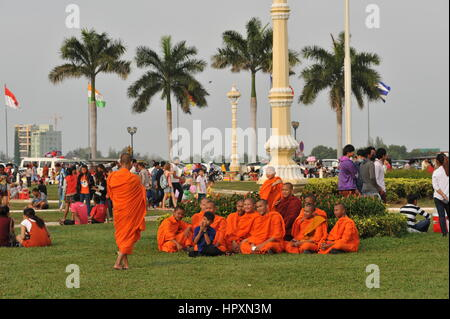 Buddhist monks take a group photo in The Royal Palace Park near the riverside during Chinese New Year, Phnom Penh, - Stock Photo