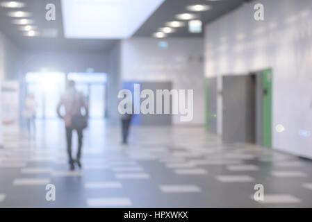 Corridor in a modern business center or a university hall - defocused with bokeh lights - Stock Photo