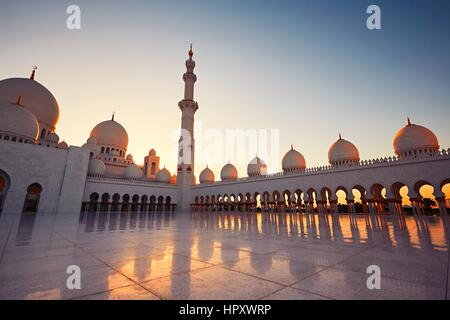 ABU DHABI, UNITED ARAB EMIRATES - April 19: Court yard and minaret of the Sheikh Zayed Grand Mosque on April 19 - Stock Photo