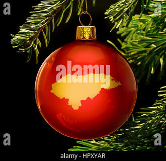 A red bauble with the golden shape of  Honduras hanging on a christmas tree isolated on black.(series) - Stock Photo