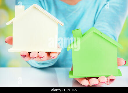 concept comparison between normal house and low consumption house - Stock Photo