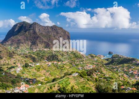 The northern coast of Porto da Cruz with Penha da Águia seen from the Miradouro Porto da Cruz, Madeira, Portugal. - Stock Photo