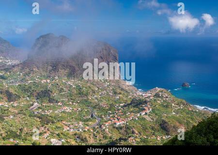 The northern coast of Porto da Cruz with Penha da Águia seen from the Miradouro da Portela, Madeira, Portugal. - Stock Photo