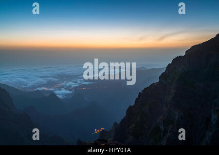 Sunrise seen from Miradouro do Ninho da Manta at Pico do Arieiro, Madeira, Portugal. - Stock Photo