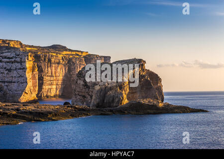 Gozo, Malta - The famous Fungus rock on the island of Gozo at Dwejra bay at sunset - Stock Photo
