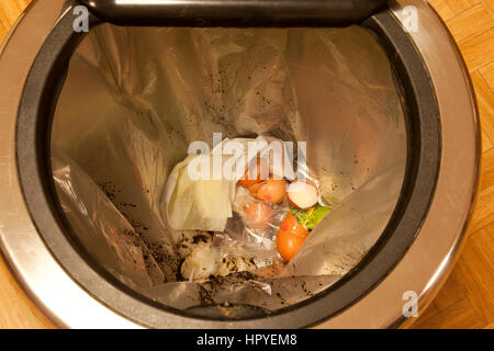 Household food waste in a domestic kitchen bin Stock Photo