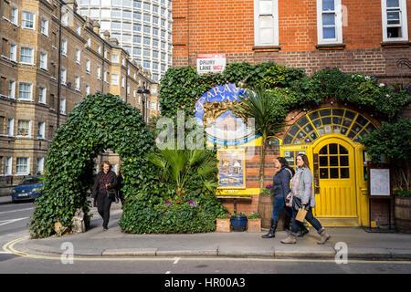 People walking in front of Sarastro restaurant, a Turkish-oriented Mediterranean dining, in Drury Lane, Covent Garden, - Stock Photo