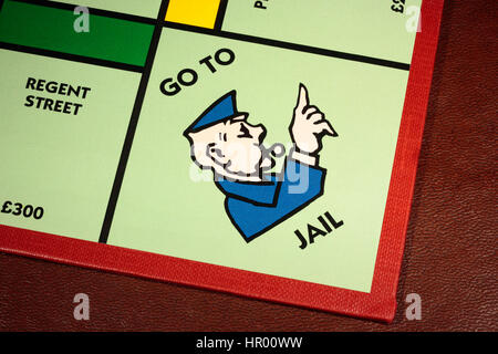 Monopoly board game GoTo Jail with Regents Street on the left - Stock Photo