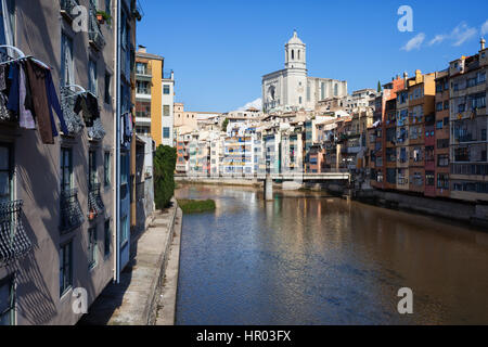 Old Town of Girona cityscape at River Onyar in Spain, historic city centre skyline with Cathedral at the far end. - Stock Photo