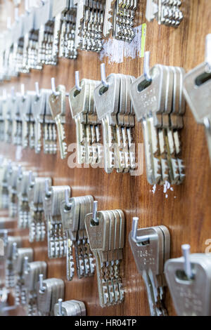 to several hooks hang there are several keys - Stock Photo