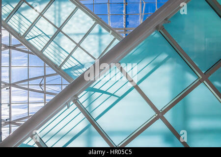detail shot of a modern office building with beautiful architecture made with lots of glass and steel - Stock Photo