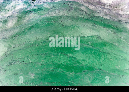 Wave of a ferry ship on the open ocean. Green water wake of a boat on the sea. - Stock Photo