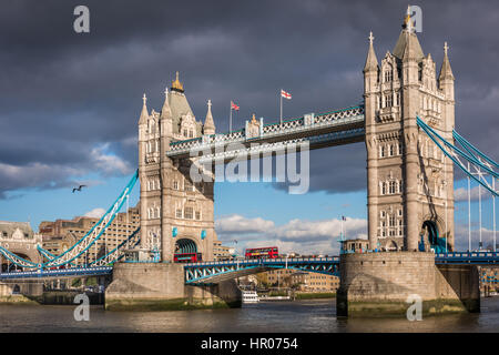 The iconic Tower Bridge lights up in the sunshine on a calm but cold day in the capital city of London. - Stock Photo