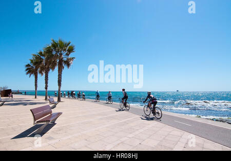 PORTIXOL/MOLINAR, MALLORCA, BALEARIC ISLANDS, SPAIN - APRIL 10, 2016: Peaceful bench seat with ocean view among - Stock Photo