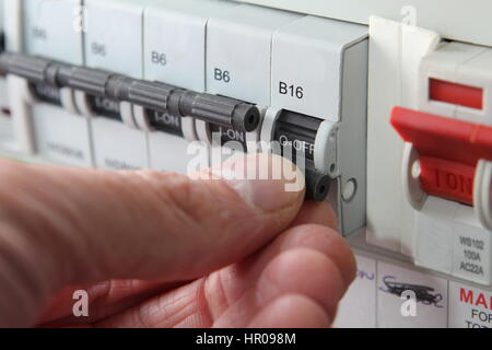 a domestic fuse box england stock photo royalty image switching an mcb micro circuit breaker on a uk domestic electrical consumer unit or
