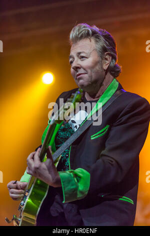 Brian Setzer, formerly of the Stray Cats leads the field in rockabilly music. Seen here with his Shockabilly Riot - Stock Photo