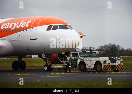 easyJet Airbus plane A319-111 at London Southend Airport being pushed into position for starting by a Schopf F110 - Stock Photo