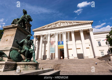 Hungarian National Museum, a neoclassical building in Budapest, and the Statue of Arany Monument, Hungary - Stock Photo